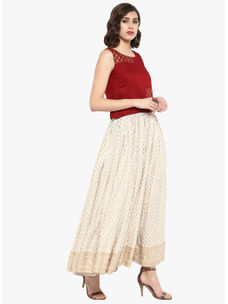 Varanga Ivory gold printed crop top  with round neckline,  & embroidery. ivory gold printed, mid rise skirt with flared hemline