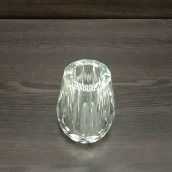 Crystal vase with faces