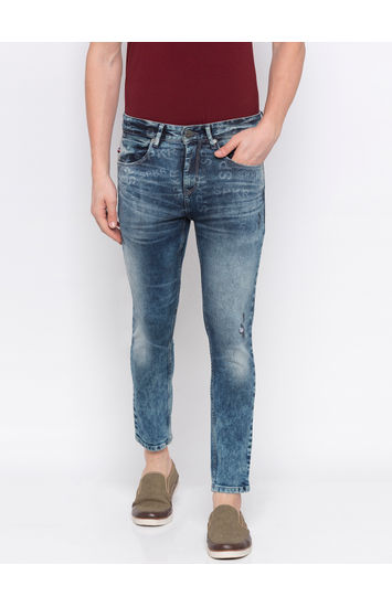 Mid Blue Ripped Tapered Jeans