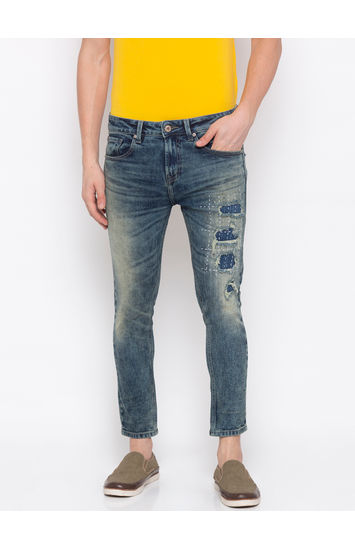 Vintage Blue Ripped Tapered Jeans