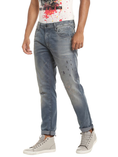 Distressed Low Rise Slim Blue Jeans