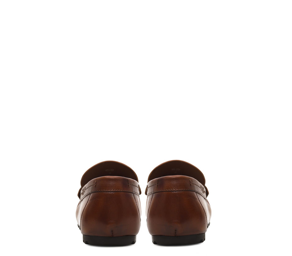 Plain Tan Moccasins With Leather Tassles